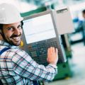 industrial factory worker working in metal manufacturing industry